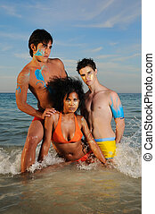 Multiracial friends on the beach - Portrait of young diverse...