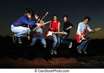 Crazy musical band - Portrait of young trendy teenager group...