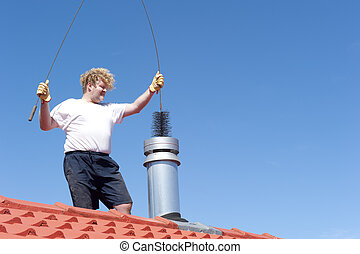 Man cleaning chimney on tiled roof - Man standing on rooftop...