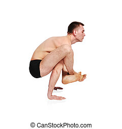 yoga position - man practicing yoga in position