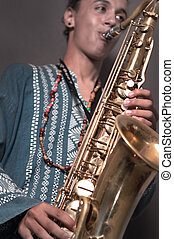Man playing saxo - Portrait of young man playing saxophone