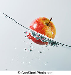 Floating apple - Apple floating in clear water