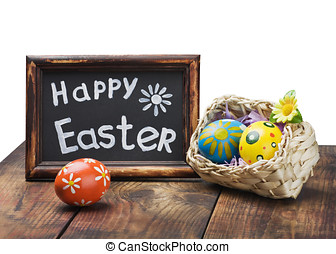 Painted Easter eggs in a basket on the table with a congratulatory text isolated on white background
