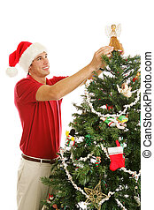 Decorating Christmas Tree - Placing Angel - Tall handsome...