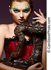Serpent Fantasy Fancy Woman holding Tamed Snake in Hands