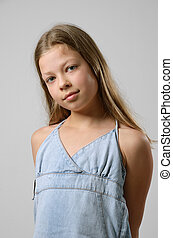 Preteen girl - A preteen girl is standing and looking at the...