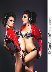 Bdsm. Sultry Women Girlfriends Hugging. Dance. Nightlife