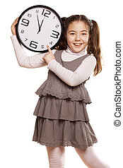 It is time - smiling little girl showing on the clock a...