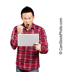 Asian Man With Touch Pad - Asian man with touch pad in his...