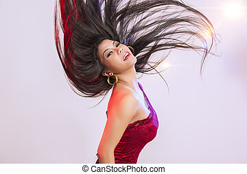 Beautiful woman tossing her hair - Beautiful woman in a...