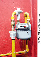 gas meter on the red wall