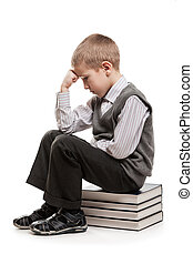 Thinker child sitting on reading books - Puzzled or...