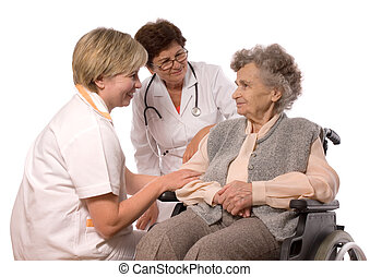 elderly woman in wheelchair - Health care workers and...