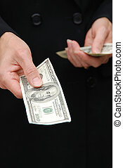 Bribery - A women dressed in black holding money with one...