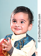 Smiling Indian Baby in Traditional Clothing