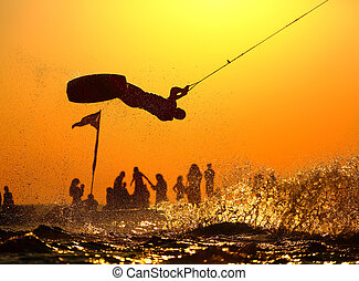 Wakeboard rider jumping on the beach