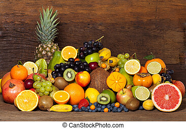 Mega Fruitmix - Many different tropical fruits in front of a...