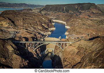 Hoover Dam and Bridge - Aerial view of a hydroelectric plant...