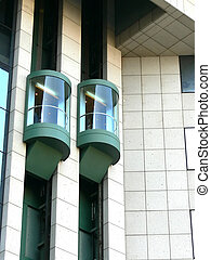 Lifts - Two panoramic elevators in a modern building