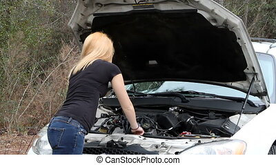 Car Not Working - Helpless teenage female looks at broken...