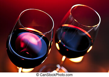 Wineglasses - Two wineglasses with red wine at candlelight