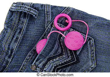 Sex toy in the pocket of a blue jeans