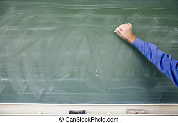 Blackboard - Teacher holding chalk about to write something...