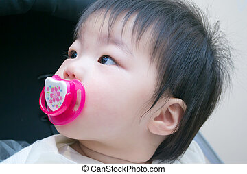 1 year old asian baby with a dummy
