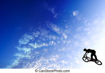 BMX Flight - Bicycle flight in the blue cloudly sky