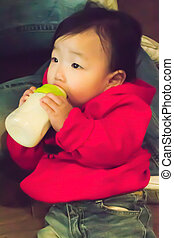 Baby girl drinking her bottle