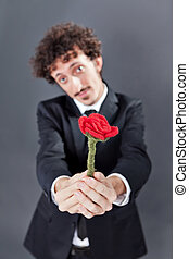 Man giving fabric rose - Boy with jacket is donating a...
