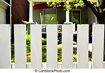 Front yard with white fence