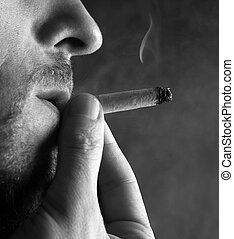 Smoking cigarette - The adult the man smokes a cigarette