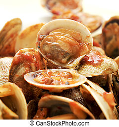 clams in marinara sauce - closeup of a plate with clams in...