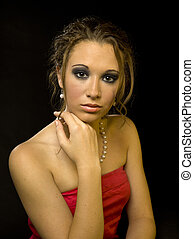 296 elegant young woman - A young woman dressed elegantly on...
