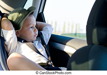 Little boy in a child safety seat
