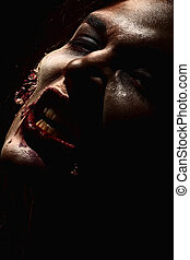 doomsday - Close-up of a bloodthirsty zombi over black...
