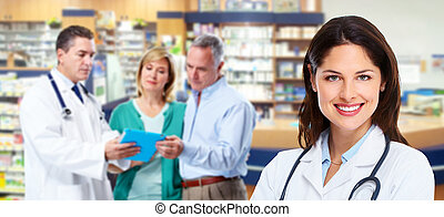 Pharmacist with a senior couple. - Pharmacist and a senior...