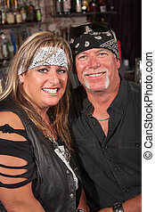 Smiling Couple in Bandannas - Handsome middle aged couple in...