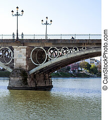 Triana bridge located in the Spanish city of Seville, across...