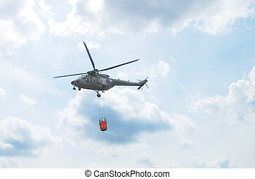 Helicopter - Czech military helicopter against a blue sky