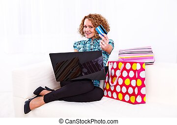 I love to shop online - Smiling redhair woman at home...