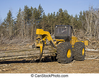 Log Skidder - Log skidder hauling out freshly cut trees