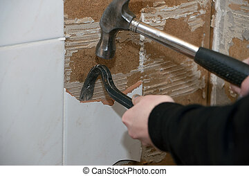 Renovation tile removed - Tile being removed, young woman...