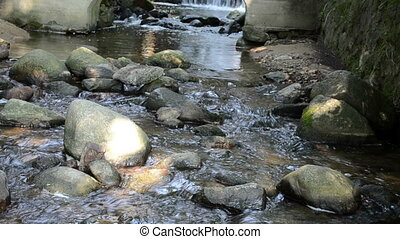 water flow mill arch - stream water flow run cascade between...