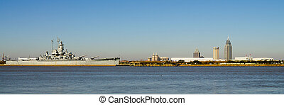Panoramic of Mobile, Alabama, skyline with U.S.S. Alabama in...