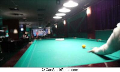 Playing russian billiard in a poolroom, defocused view