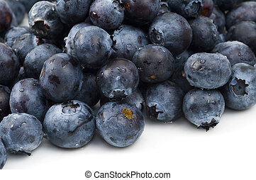 Blueberries - Close-up of a bunch of blueberries on a white...