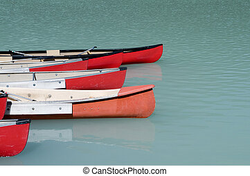 Canoes on Emerald Lake - Canoes on a glacier fed lake in...