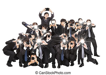 many photographers holding camera pointing to you and...